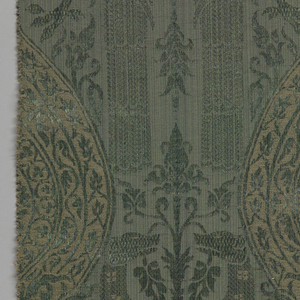 Reproduction textile with a design of paired birds and dogs standing over a foliate ogive. Adapted from from the Cooper Union Museum collection.
