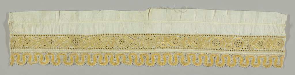 Border in a stylized floral design with cutwork embroidery and a Sicilian filet border in yellow.