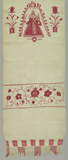 """Towel ornamented with three bands of embroidery; one showing the Virgin and Child under a canopy with """"1740 DRAD"""" and two flowering scrolls.  At the bottom, a band of darning and knotted fringe."""