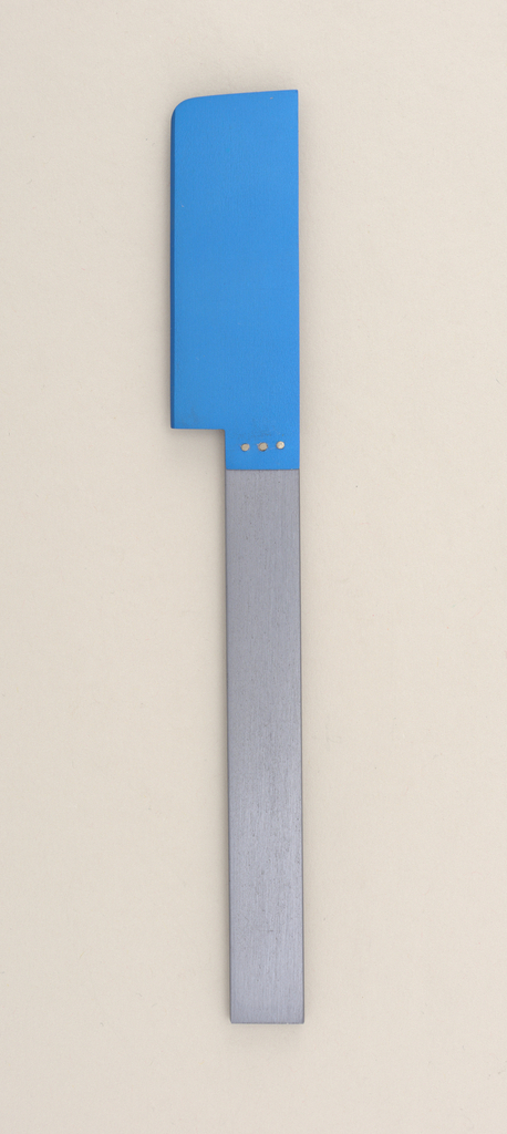 Flat rectangular handle of grey aluminum; brushed surface. Rectangular aluminum blade, anodized blue, with rounded outer point and bevelled cutting edge. Blade affixed to handle side with three silver rivets.