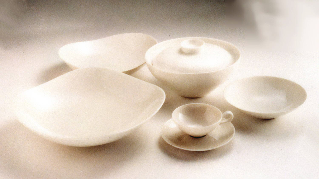 White porcelain cup, with loop handle, and saucer with lifted well.