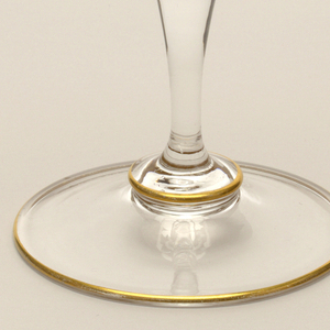 Mouth-blown crystal wine glass, hand-painted with gold rims.