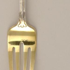 """Of """"Martele"""" silver, the handle decorated with a native lily motif and initials E.K.G. conjoined."""