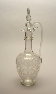 "Mouth-blown crystal pitcher with stopper, cut and polished ornamental engraving in the ""Greek"" style."