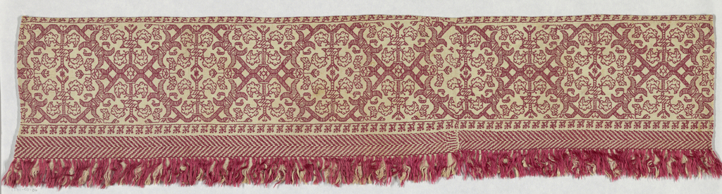 Band showing a row of elaborate diamond shapes with symmetrical flowers. In red silk on linen.