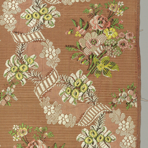 "Twined ribbons supporting bunches of flowers on a ribbed ""flushing"" warp background."