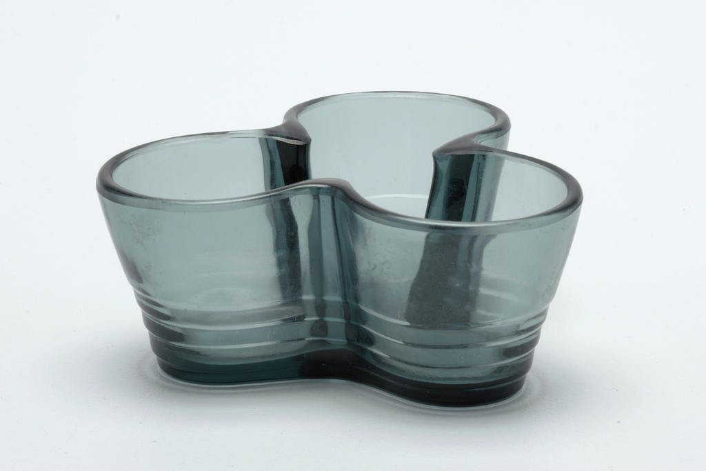 a molded glass dish, three-lobed form, smoky blue-gray glass.