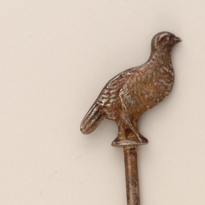 Pointed straight blade, the terminal formed as a cast partridge-like bird.