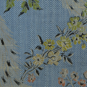 Blue ground fabric with all-over diaper pattern produced by floats of the secondary blue warps. Pattern of polychrome floral serpentines and plumes in white. Details of the pattern are in dark brown.