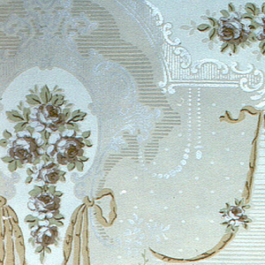Floral medallions with hanging ribbons. Alternating motifs are connected by swags.