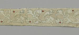Heads of cherubs over diagonal flowering scrolls.