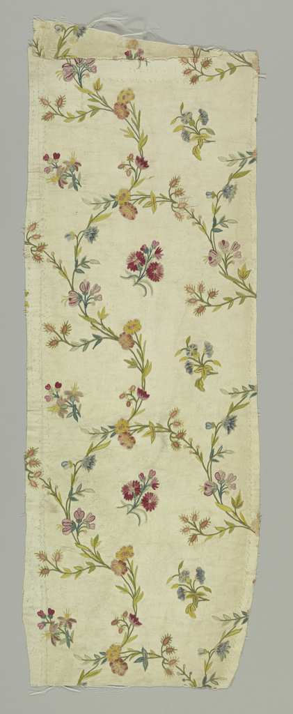 White ribbed silk embroidered in colored silks and chenille (in chain stitch) in design of interlacing stems and floral sprays.