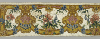 White satin valence embroidered in Chenille; shades of gold color, brown, green, blue and rose. Pattern: horizontal arrangement of heavy curves and shell shape, alternating with life size flowers in clusters; above, narrow border in baroque curves. Piece is backed with unbleached linen and worked through it. Much of gold color chenille couched.