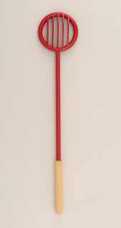 Red plastic server with expody coated natural wood handle.