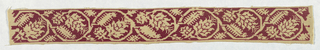 Natural linen band embroidered in red silk with a scrolling vine with a flower blossom enclosed in each scroll. Embroidery fills the ground, with the design reserved in natural linen.