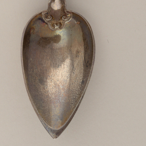 Pointed oval bowl, partly fluted then twisted stem with circular gadrooned crusher terminal.