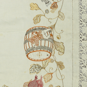 Seventeen embroidered gnomes walking on vines and leaves. Each carrying a different fruit, vegetable or objects such as: radishes, grapes, a wine cup, foaming beer mug, sausage, egg, carrots or turnips, cherries, wheat, mushrooms, strawberries, raspberries, lobster, and a barrel of wine dated 1890.