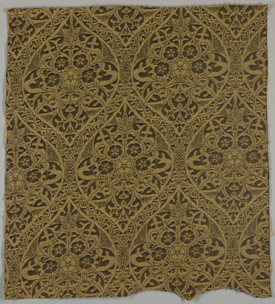 Ogee grid with flowers and insects. Warp is ocher and weft is brown.