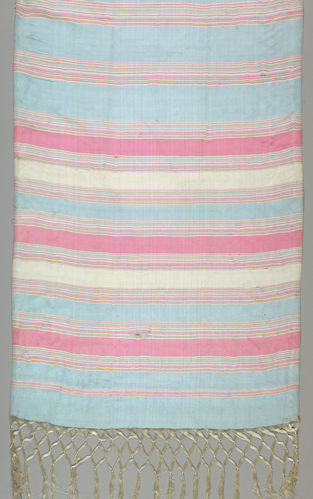 Broad sash of vertically ribbed silk plain cloth. Striped horizontally pale blue, pink, white, and yellow. Long knotted white silk fringe formed by warp ends.