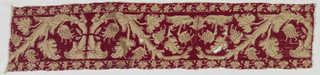 Border of red silk on linen showing a branch with leaves and flowers.