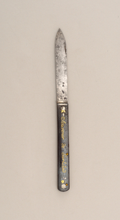 "Leaf-shaped blade, handle straight-sided with engraved floral decoration with gold inlaid leaves and gold inlay inscription ""Souvenir de Carlsbad"" on the front side. Blade folds into handle."