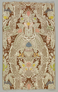 """Vertically symmetrical pattern of the """"lace"""" type on a rust-red background."""