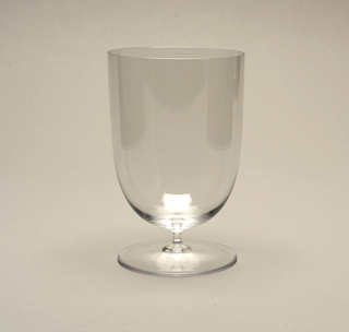 Thin mouth-blown glass water glass, deep cylinder with rounded bowl on short stem and circular foot