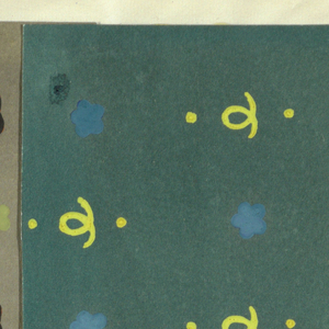 Small patterns of alternating fleurettes and curly cues and dots in yellow and blue on dark green background.