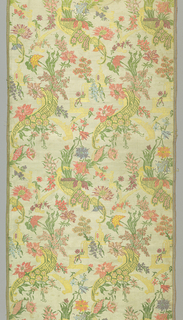 Cream coloured silk panel brocaded in the 'bizarre' style with polychrome silks showing design of serpentine, cornucopia filled with flowers, and connected with strapwork. Both selvages present.