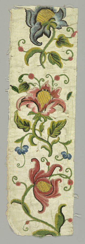 Panel of white silk taffeta, backed with linen, with embroidered design in blue, black, and rose silk threads, green, yellow, rose and black chenille, gold metal thread, and flat strips of metal and yellow taffeta applique worked through both silk and linen. Incomplete design showing three large-scale polychrome flowers