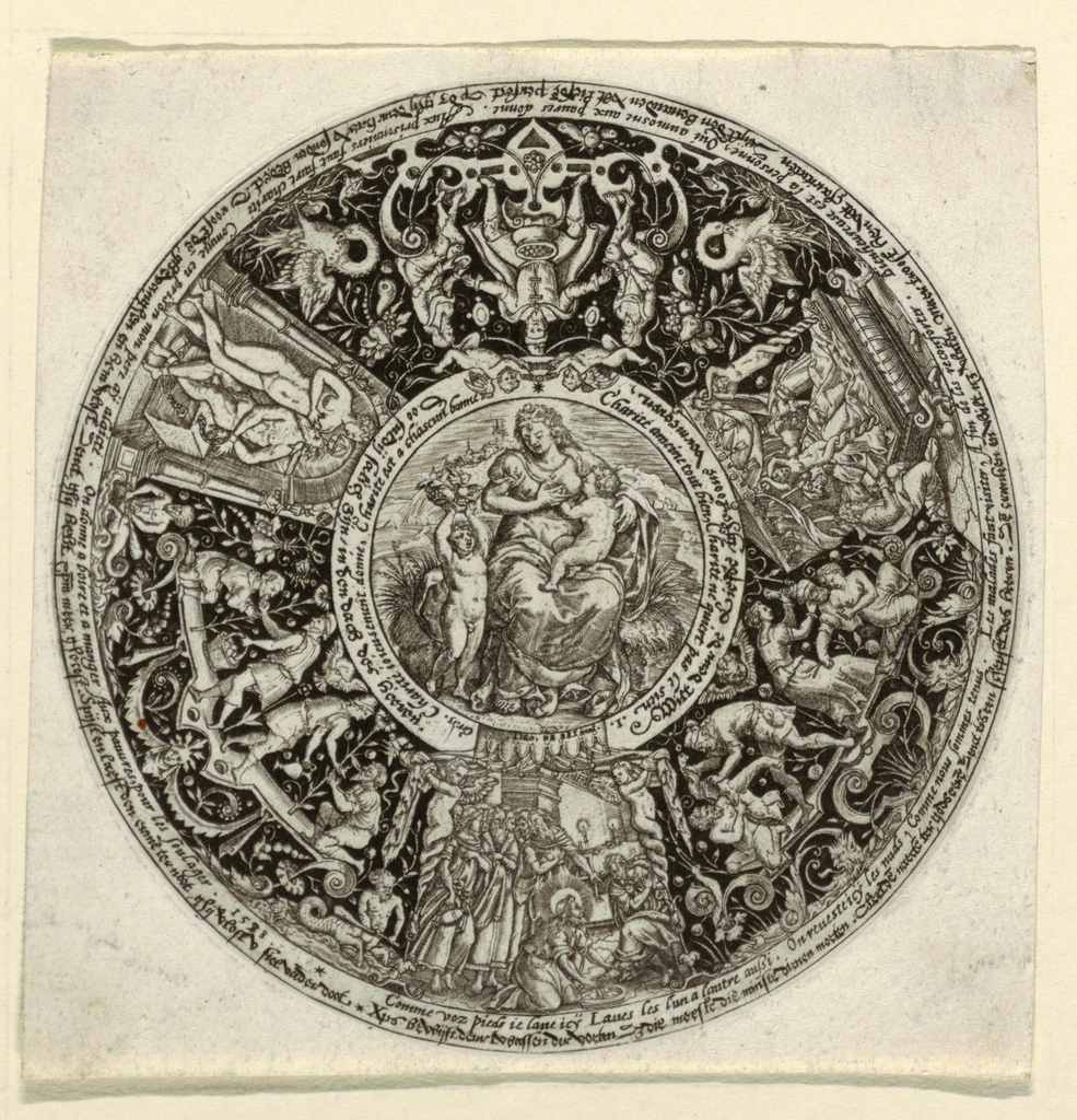 Circular; a representation of Charity in the central medallion. Representations of works of charity outside: Christ washing the feet of the disciples. Care of the wounded and sick; alms; Cimon chained and suckled by his daughter. Distribution of food to the poor. Inscriptions in French and Low German.