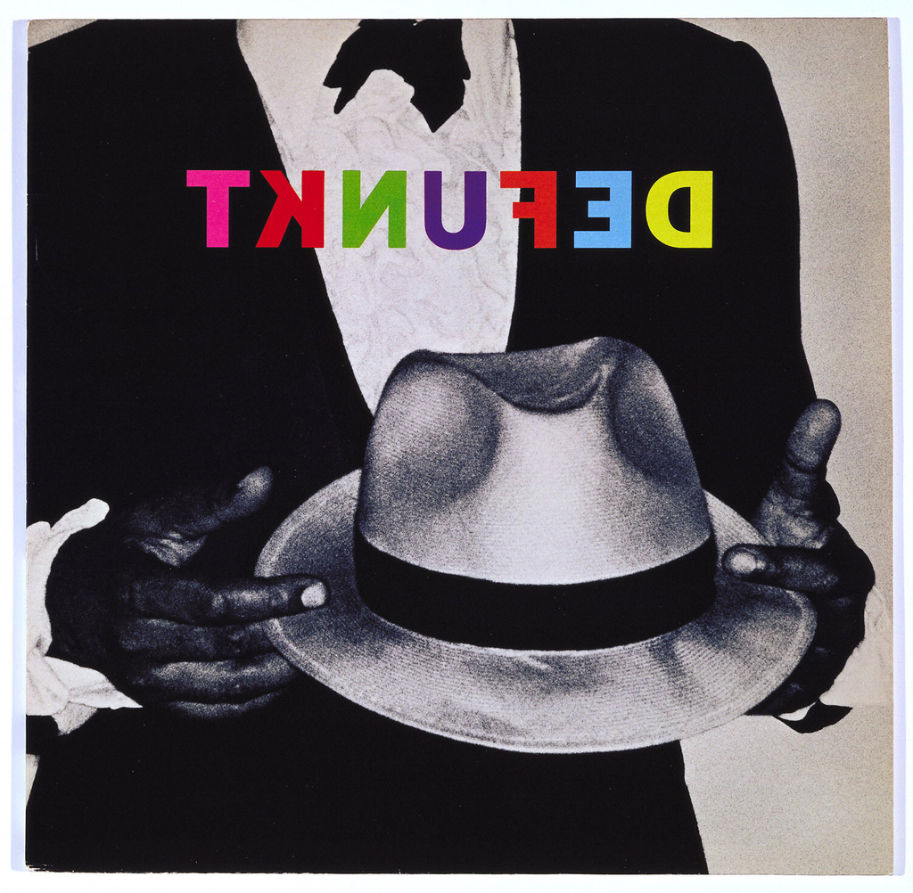 Recto: Partial view (shoulders to below the waist)  of a photograph of a man in a black jacket, white shirtfront and black bowtie, with his hands across his midsection holding a fedora; Defunkt is imprinted, in reverse, in multicolored capital letters across the upper section of the figure. Verso: On a chartreuse background, in the upper half, Defunkt is imprinted in capital letters in black. In the lower half is a small group photograph of some of the band members, composed of six men, five of whom are in white jackets and one in a black jacket, white shirt and black bowtie, a fedora in his left hand (the same figure as in the recto image) and one woman in a black dress. The album numbers and personnel are listed below the photograph.