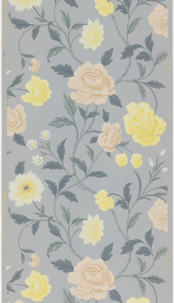 Large-scale vining floral pattern. Mauve, white and yellow flowers printed on a blue ground.