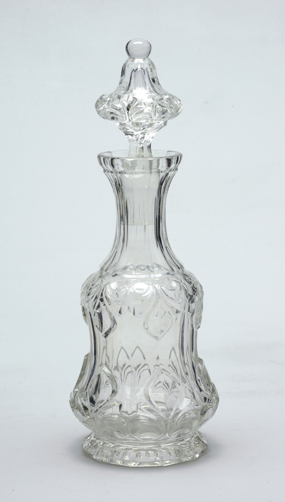 Mouth-blown crystal, richly cut and polished with facets and leaf ornamentation.