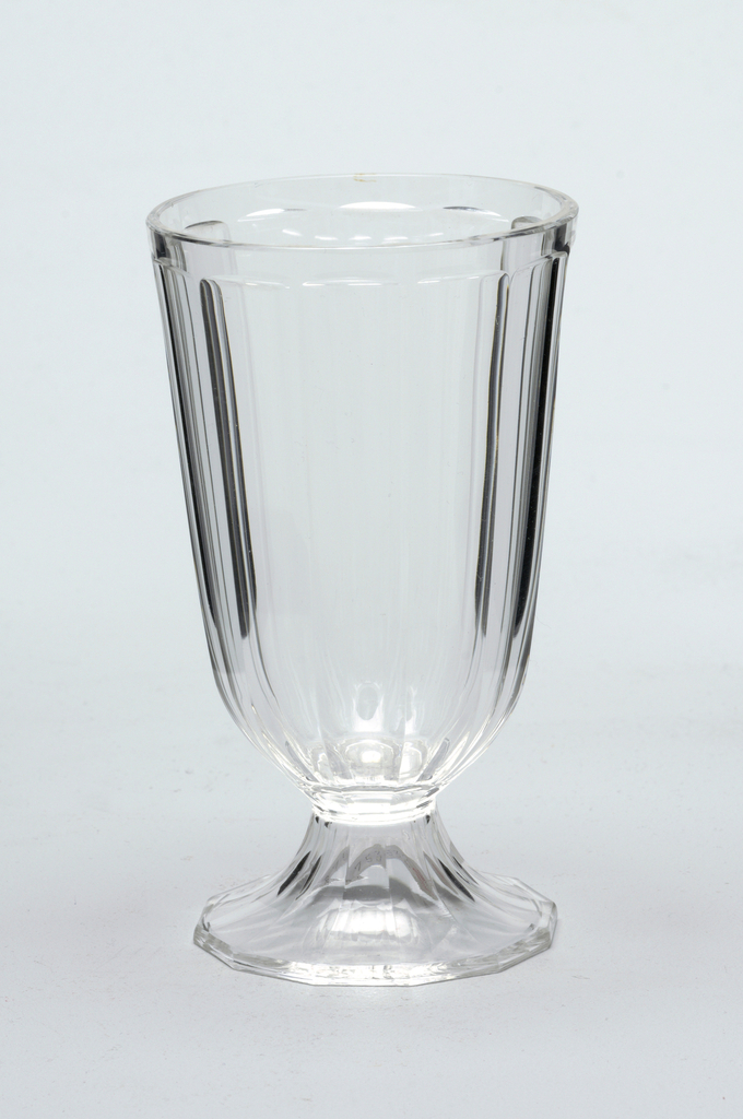 Mouth-blown crystal water glass, elaborately facet-cut and polished, with precisely planned bubble in the stem.