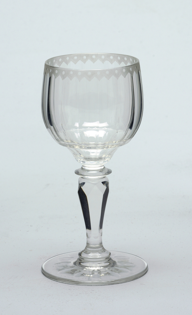 Mouth-blown crystal wine glass, elaborately facet-cut and polished.