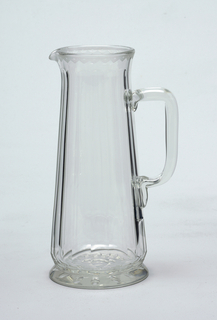 Mouth-blown crystal pitcher, elaborately facet-cut and polished.