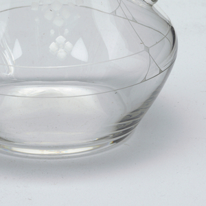 Mouth-blown crystal wine pitcher with stopper, with dainty floral engraving.