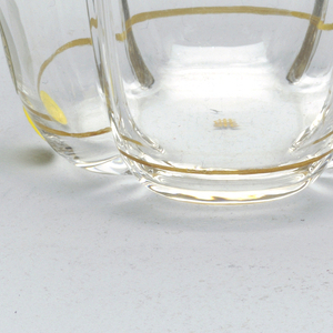 Mouth-blown crystal water tumbler, hand-painted with gold rims.