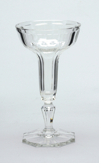"""Tulip shape"" glass of mouth-blown crystal champagne glass, elaborately facet-cut and polished, with precisely planned bubble in the stem."