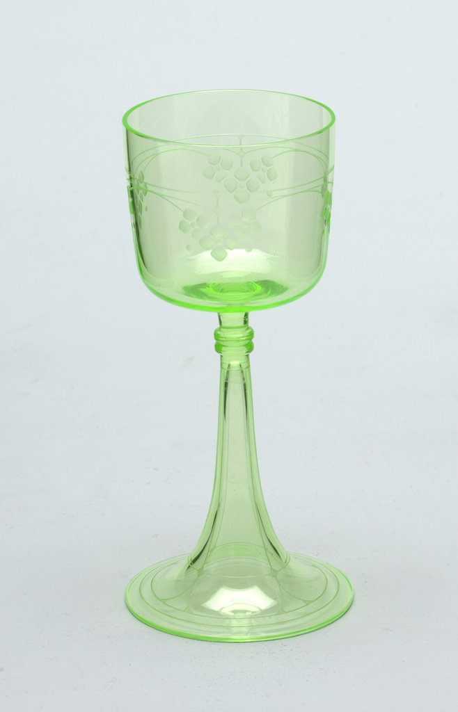 Green mouth-blown crystal wine glass, with dainty floral engraving.