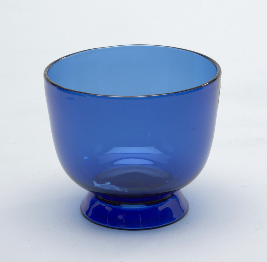 Thin, blue, mouth-blown footed crystal bowl.