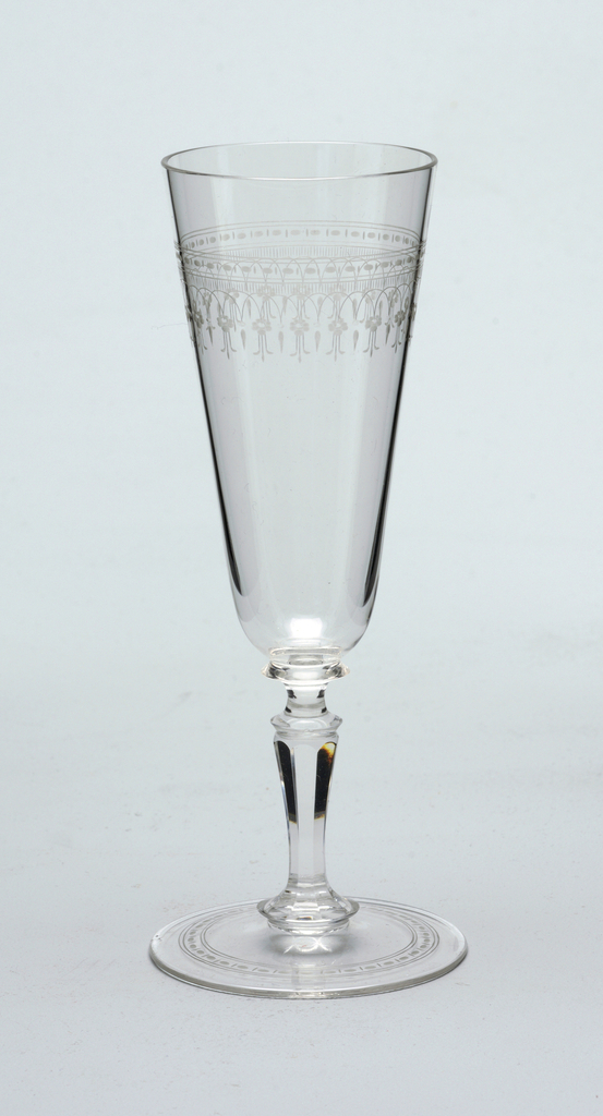 Mouth-blown crystal champagne flute, partly facet-cut and polished, with a dainty floral engraved border.