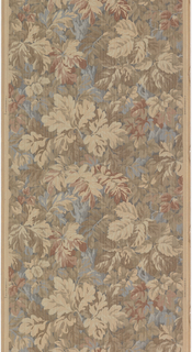 Large-scale all-over leaf design, having the appearance of a tapestry. Printed in tan, brown, green and blue on tan ground. Overprinted with fine lines.