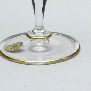Mouth-blown crystal champagne flute, hand-painted with gold rims.