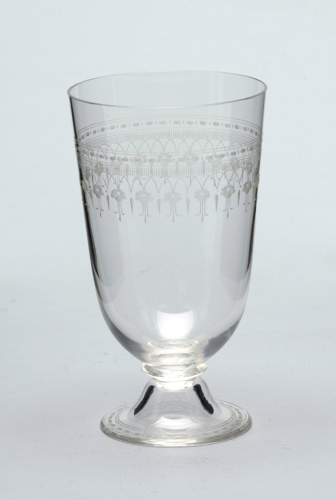Mouth-blown crystal water glass, partly facet-cut and polished, with a dainty floral engraved border.