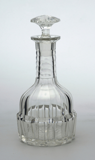 Mouth-blown crystal wine decanter, faceted and relief-prismatic-cut and polished.