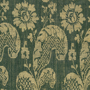 Allover pattern in yellow and green of two types of long curved flowering plants: one type in one row, the other in the next row in offset alignment. Yellow silk woven weft-loop fringe attached to top, bottom and one side.