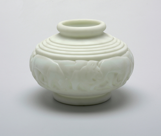 White opaque molded glass vase with border of lions.