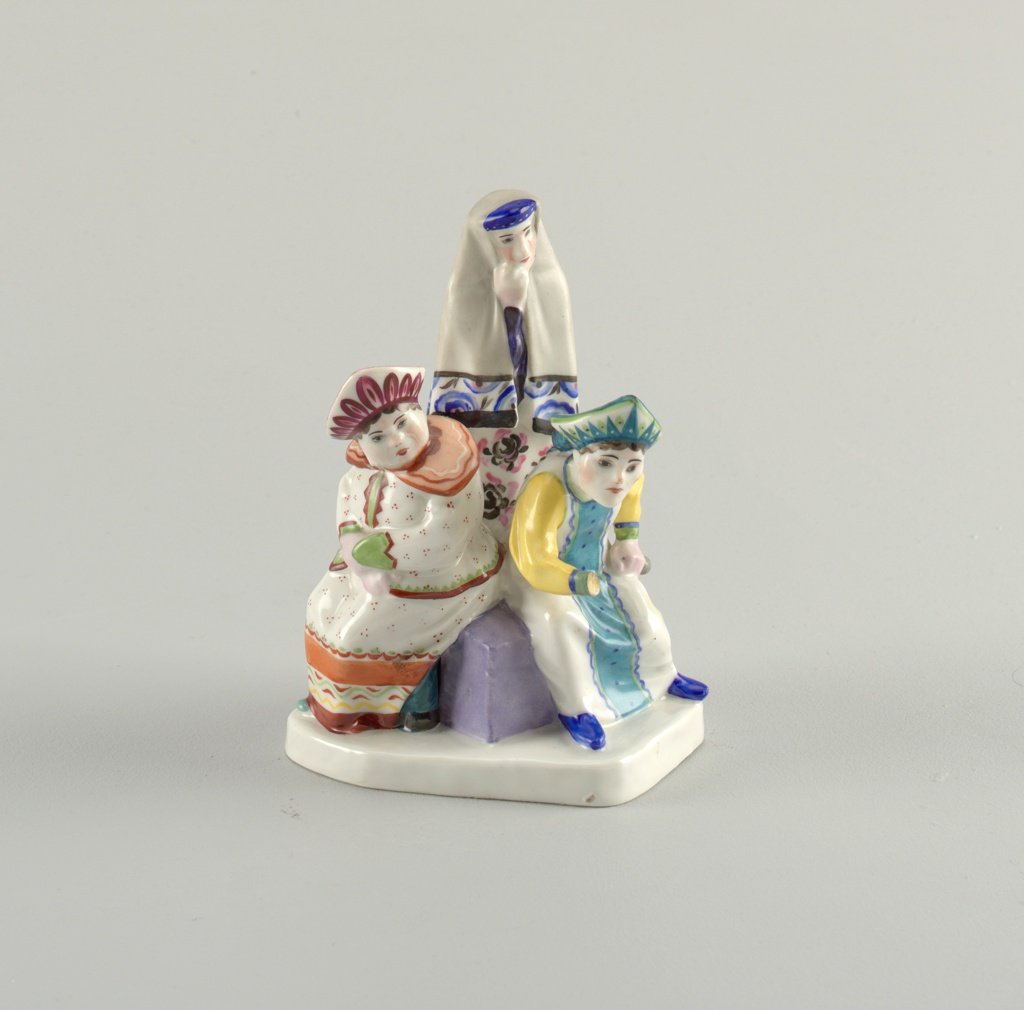Three figures, two seated, one standing behind: standing figure with shawl over head, seated figures wearing kokoshniks.
